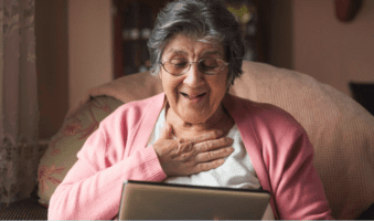 grandmother using a handheld device to connect with family